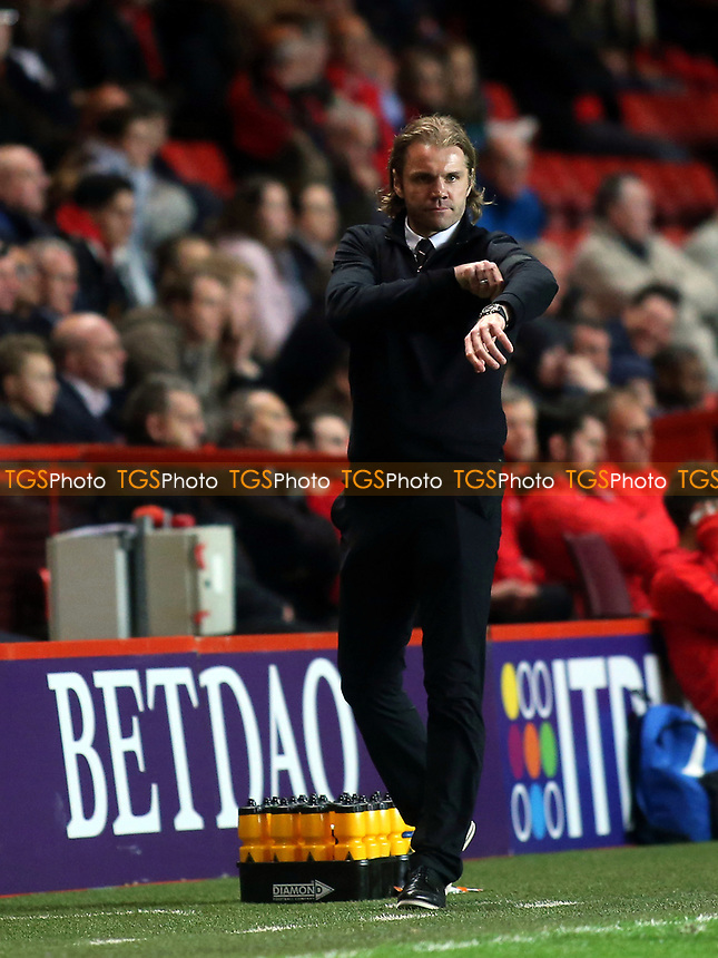MK Dons Manager, Robbie Neilson, adjusts his black armband during Charlton Athletic vs MK Dons, Sky Bet EFL League 1 Football at The Valley on 4th April 2017