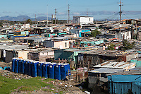 South Africa, Cape Town, Khayelitsha Township.  Blue Portable Toilets in Foreground.