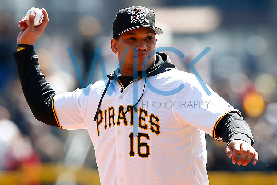 James Conner #24 of the Pittsburgh Panthers throws out the first pitch during the Opening Day game between the Pittsburgh Pirates and the St. Louis Cardinals at PNC Park in Pittsburgh, Pennsylvania on April 3, 2016. (Photo by Jared Wickerham / DKPS)