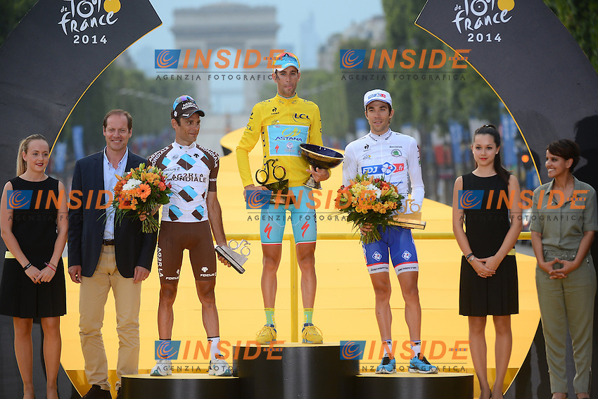 second PERAUD Jean-Christophe (FRA - AG2R La Mondiale), overall winner and yellow jersey NIBALI Vincenzo (ITA - Astana Pro team) and third PINOT Thibaut (FRA - FDJ.fr) <br /> Podium <br /> Vincenzo Nibali maglia Gialla vince il Tour de France <br /> Ciclismo Tour de France 27-07-2014<br /> 21ma Tappa - Evry / Paris Champs Elysees <br /> Foto Insidefoto
