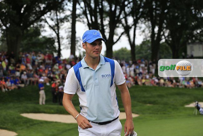 Martin Kaymer (GER) walks off the 13th green during Thursday's Round 1 of the 95th US PGA Championship 2013 held at Oak Hills Country Club, Rochester, New York.<br /> 8th August 2013.<br /> Picture: Eoin Clarke www.golffile.ie