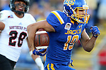 BROOKINGS, SD - SEPTEMBER 12:  Jake Wieneke #19 from South Dakota State races to the end zone for a touchdown past Miles Killebrew #28 from Southern Utah in the first half of their game Saturday night in Brookings. (Photo by Dave Eggen/Inertia)