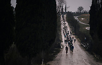 peloton down a tricky descent on the muddy course<br /> <br /> 12th Strade Bianche 2018<br /> Siena &gt; Siena: 184km (ITALY)