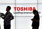 July 21, 2015, Tokyo, Japan - Members of the media await the start of news conference in the lobby of Toshiba Tokyo head office on Tuesday, July 22, 2015. Toshiba President Hisao Tanaka announced his resignation, taking responsibility for his part in manipulating deceptive accounting during the news conference.  (Photo by Natsuki Sakai/AFLO) AYF -mis-