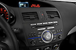 Stereo audio system close up detail view of a 2010 Mazda 3 5-Door S Grand Touring
