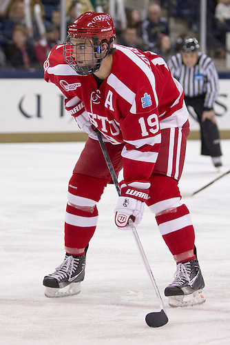 Boston University forward Justin Courtnall (#19) in first period action of NCAA hockey game between Notre Dame and Boston University.  The Notre Dame Fighting Irish defeated the Boston University Terriers 5-2 in game at the Compton Family Ice Arena in South Bend, Indiana.