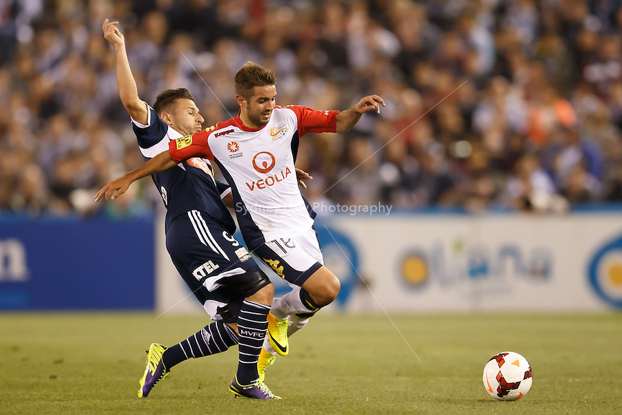 Kosta BARBAROUSES of the Victory and Michael ZULLO of Adelaide compete for the ball in the round seven match between Melbourne Victory and Adelaide United in the Australian Hyundai A-League 2013-24 season at Etihad Stadium, Melbourne, Australia.<br /> This image is not for sale. Please visit zumapress.com for image licensing.
