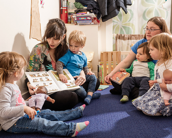 April 7, 2017. Durham, North Carolina.<br /> <br /> Lis Tyroler, center, one of the owners of Nido, reads with daycare students (left to right) Filomena Overington, Tyroler's son Sebastian Tyroler Romine, Caleb Miller D'Silva and Violet Steitler in the on site daycare center. <br /> <br /> Nido is a co-working space which also offers a Montessori preschool on site. Catering to working parents with morning and afternoon preschool shifts, Nido has thrived and is actively looking for a larger space. <br /> <br /> Jeremy M. Lange for The New York TImes
