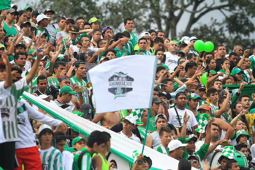 FLORIDABLANCA -COLOMBIA, 03-08-2014.  Seguidores de Atlético Nacional muestran su apoyo durante el encuentro contra Alianza Petrolera por la fecha 3 de la Liga Postobon II 2014 disputado en el estadio Alvaro Gómez Hurtado de la ciudad de Floridablanca./ Followers of Atletico Nacional show their support during match against Alianza Petrolera for the 3th date of the Postobon League II 2014 played at Alvaro Gomez Hurtado stadium in Floridablanca city Photo:VizzorImage / Duncan Bustamante / STR