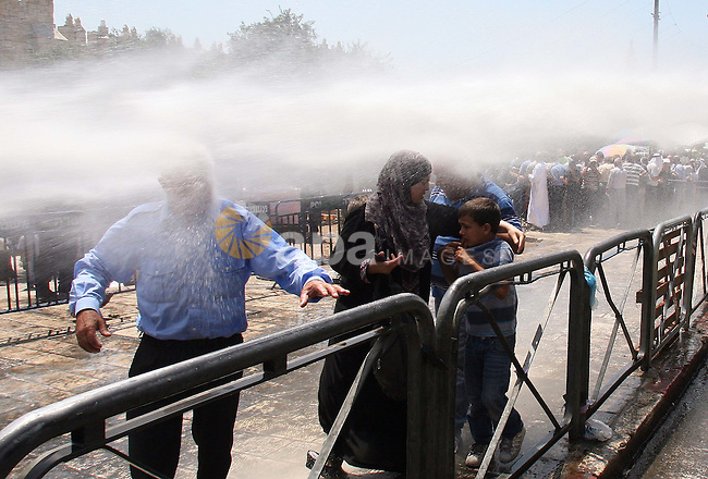 Israeli police uses a water canon to disperse a crowd of Palestinians outside Damascus Gate in Jerusalem's Old City Friday, Aug. 19, 2011. Dozens of Palestinians trying to reach the Al-Aqsa Mosque in Jerusalem for Muslim prayers during the Muslim holy month of Ramadan scuffled with police at one of the gates to the Old City. The police were allowing access only to older Muslims in a measure police said is meant to prevent unrest. Photo by MUAMMAR AWAD