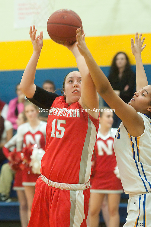 WINSTED, CT--- -011516JS03--Northwestern's Gina Weingart (15) lays up a shot in front of Gilbert's Deanna Delacruz (23) during their game Friday at the Gilbert School in Winsted. <br />  Jim Shannon Republican-American