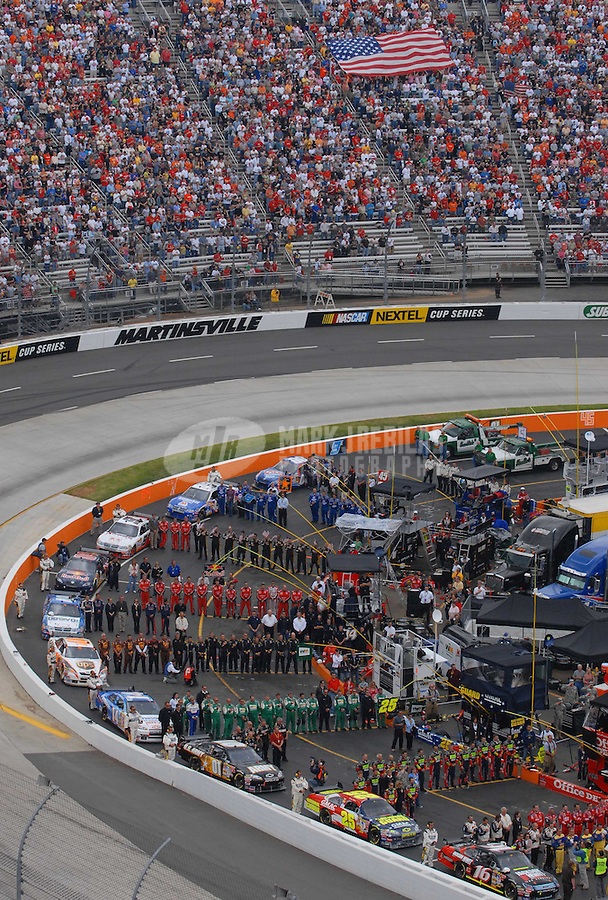 Apr 1, 2007; Martinsville, VA, USA; Nascar Nextel Cup Series teams line up on pit road during the national anthem prior to the Goody's Cool Orange 500 at Martinsville Speedway. Martinsville marks the second race for the new car of tomorrow. Mandatory Credit: Mark J. Rebilas