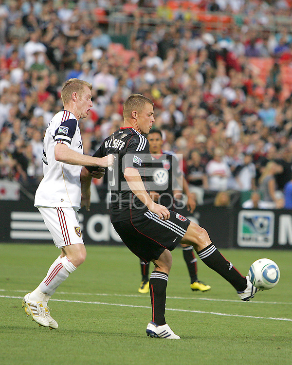 Danny Allsopp #9 of D.C. United makes a pass in front of Nat Borchers #6 of Real Salt Lake during an MLS match at RFK Stadium, on June 5 2010 in Washington DC. The game ended in a 0-0 tie.