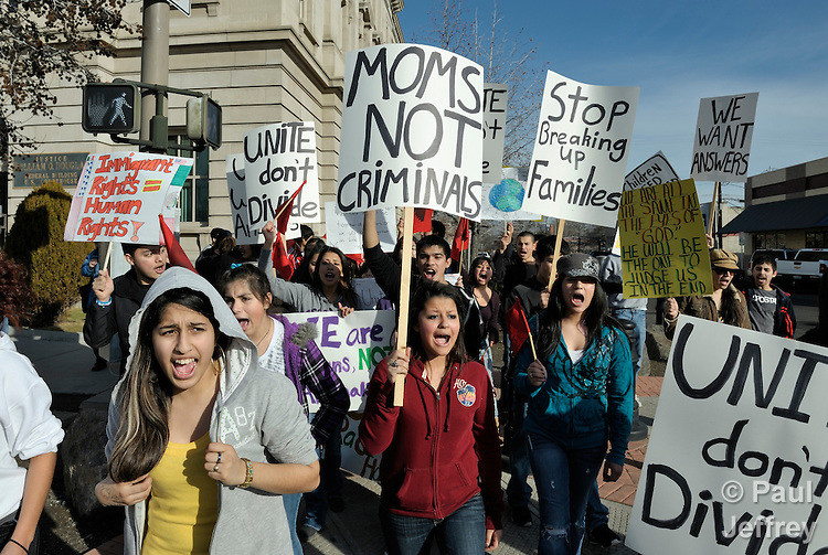 Claudia Amaya (center, in red sweater), a 15-year old from Ellensburg, Washington, participates in a demonstration outside the U.S. federal court in Yakima, Washington, to express support for people arrested in a January 20 immigration sweep in Ellensburg. The demonstration in Yakima included dozens of youth, some with relatives who were arrested, who walked out of their high school classes and drove to Yakima to demonstrate outside the court, where hearings on the arrests were taking place. Churches in Ellensburg, a university town east of the Cascade Mountains, formed the nucleus of a local group organized to support the affected families.