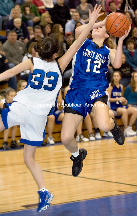 BURLINGTON, CT- 23 FEB 2008- 022308JT05-<br /> Shepaug's Jackie DeVito triess unsuccessfully to block a layup from Lewis Mills' Stefanie Schur during Saturday's Berkshire League tournament final at Lewis Mills. The Spartans (LM) won 30-26.<br /> Josalee Thrift / Republican-American