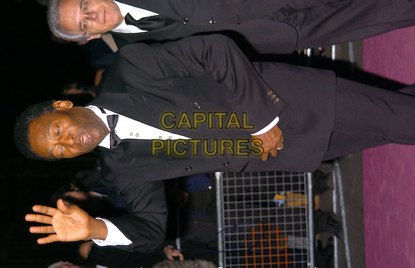 PELE.Fifa 100 Charity Auction & Tribute Ceremony .4 March 2004.half length, half-length, waving, blinking.www.capitalpictures.com.sales@capitalpictures.com.©Capital Pictures
