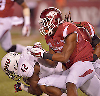 STAFF PHOTO BEN GOFF  @NWABenGoff -- 09/20/14 <br /> Arkansas cornerback D.J. Dean, right, helps tackle Northern Illinois tailback Cameron Stingily during the fourth quarter of the game against Northern Illinois in Reynolds Razorback Stadium in Fayetteville on Saturday September 20, 2014.