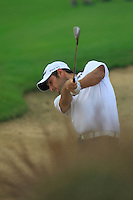 Alexander Levy (FRA) in a fairway bunker for his 2nd shot on the 10th hole during Friday's Round 2 of the 2014 BMW Masters held at Lake Malaren, Shanghai, China 31st October 2014.<br /> Picture: Eoin Clarke www.golffile.ie