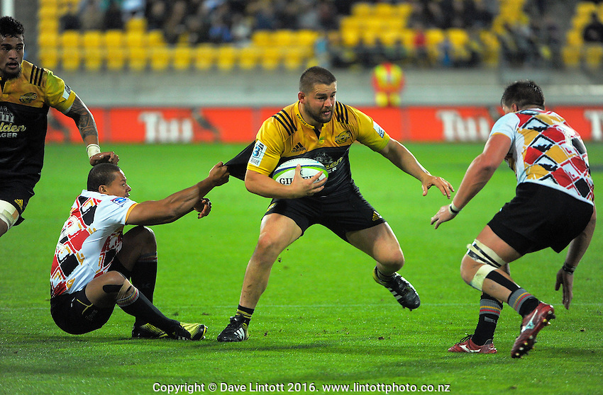 Dane Coles is scragged during the Super Rugby match between the Hurricanes and Southern Kings at Westpac Stadium, Wellington, New Zealand on Friday, 25 March 2016. Photo: Dave Lintott / lintottphoto.co.nz