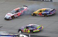 May 31, 2008; Dover, DE, USA; Nascar Nationwide Series driver David Ragan (6) spins after contact with Jason Keller (11) as Josh Wise (22) drives below during the Heluva Good 200 at the Dover International Speedway. Mandatory Credit: Mark J. Rebilas-US PRESSWIRE