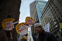 NEW YORK, NY - APRIL 15: Activists take part in a Tax Day protest on April 15, 2017 in New York City. Thousands of activists march to Trump Tower to demand that President Donald Trump release his tax returns. Photo by VIEWpress/Eduardo MunozAlvarez