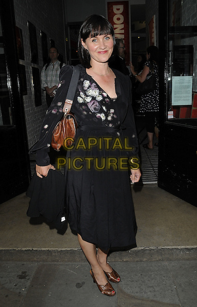 "Esther Hall.""Anna Christie"" theatre press night, Donmar Warehouse theatre, Earlham St., London, England..August 9th, 2011.full length black dress top purple floral print .CAP/CAN.©Can Nguyen/Capital Pictures."