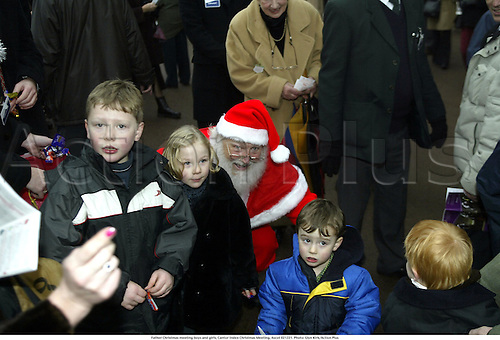 Father Christmas meeting boys and girls, Cantor Index Christmas Meeting, Ascot 021221. Photo: Glyn Kirk/Action Plus...2002.horse racing.santa national hunt