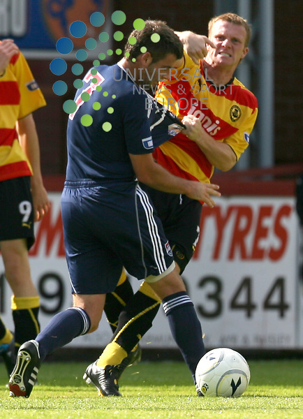 Particks  Steven McKeown appears to lash out at County player Stuart Kettlewell during the Partick Thistle v Ross County Irn-Bru Scottish League First Division at Firhill Stadium 15/08/09....Picture by Ricky Rae/ Universal News & Sport (Scotland).