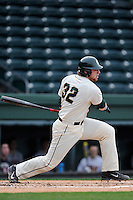 Catcher Joel Fisher (32) of the Michigan State Spartans bats in a game against the Harvard Crimson on Saturday, March 15, 2014, at Fluor Field at the West End in Greenville, South Carolina. Michigan State won, 4-0. (Tom Priddy/Four Seam Images)
