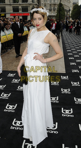 PEACHES GELDOF<br /> UK film premiere of 'Bruno', at Empire Leicester Square, London, England.<br /> June 17th, 2009  <br /> full length white dress tattoos hairband headband black clutch sleeveless long maxi hand on hip <br /> CAP/CAN<br /> &copy;Can Nguyen/Capital Pictures