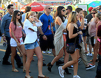 Keeping up with the Kardashians: Kris Jenner treated her daughter_Kylie and a bunch of friends with a trip to the Orange County Fair in Costa Mesa on a sunny Saturday afternoon. The Jenners were accompanied by Cody_Simpson's sister Alli_Simpson and a whole entourage of bodyguards and production people, who made sure that the outing was caught on film. ..Before the gang headed to the concert of Cody_Simpson on the Fair grounds, Kris grabbed a deep fried sweet treat and some ice cream and throw darts with_Kylie to win a stuffed animal. ..Kylie_and her friend later skipped the line at a thrill ride, which caused a couple of BOOs among the waiting crowd. The duo held hands and screamed from the top of their lungs during the ride but they clearly had a lot of fun! PICTURED: KYLIE JENNER AND ALLI SIMPSON. Costa Mesa, California on 21.7.2012..Credit: Kilian/face to face / Mediapunchinc - ***NO PRINT FOR WEEKLY MAGAZINES ONLINE ONLY**** */*NortePhoto*<br />