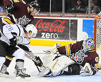 San Antonio Rampage's James Wright (28) tries to poke the puck from underneath Chicago Wolves goaltender Eddie Lack during the second period of an AHL hockey game, Wednesday, April 4, 2012, in San Antonio. (Darren Abate/pressphotointl.com)