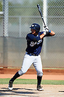 Milwaukee Brewers minor league infielder Adam Giacalone #13 at bat during an instructional league game against the Cincinnati Reds at Maryvale Baseball Park on October 3, 2012 in Phoenix, Arizona.  (Mike Janes/Four Seam Images)