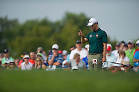 Adam Scott checks his line on the 13th green during the opening round of the US PGA Championship at Valhalla (Photo: Anthony Powter) Picture: Anthony Powter / www.golffile.ie