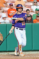 Left Fielder Tyler Slayton #18 swings at a pitch during a  game against the Miami Hurricanes at Doug Kingsmore Stadium on March 31, 2012 in Clemson, South Carolina. The Tigers won the game 3-1. (Tony Farlow/Four Seam Images).