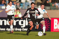 Jennifer Lalor of the New York Power is trailed by Keri Raygor and Maren Meinert of the Boston Breakers during their May 18th game at Mitchel Athletic Complex in Uniondale, NY. The Power lost 2-1.