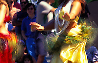 Colorful Tahitian dancers show their unique Polynesian style with hips in a frenzy of motion, Hilo, Big Island
