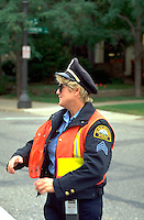 Policewoman age 40 directing traffic at Selby Day Parade.  St Paul  Minnesota USA
