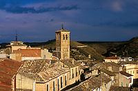Tower of Church of San Miguel, tile roofs, dark sky. Toledo Castilla-La Mancha Spain.
