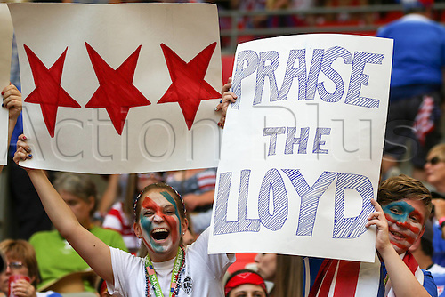 """05.07.2015. BC Place Stadium, Vancouver, BC, Canada. Banners from USA supporters state """"Praise The Lloyd"""" for their player Carli Lloyd. After a fast USA start (4-0) in the first 15 minutes, Japan scored 2 goals but the USA ran out 5-2 winners to take the trophy."""