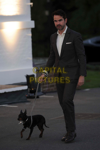 Jimmy Carr & dog.The All New Range Rover launch at the Royal Ballet School in Richmond Park, London, England..6th September 2012.full length white shirt grey gray suit walking dog animal pet leash lead side stubble facial hair mouth open.CAP/CAS.©Bob Cass/Capital Pictures.