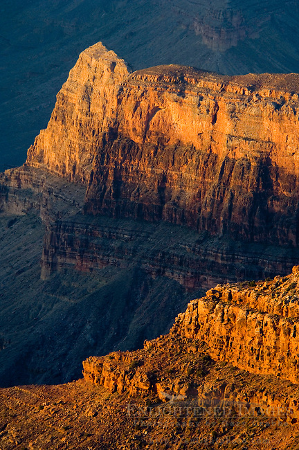 Sunrise light on red rock cliff formations below the North Rim at Point Sublime, Grand Canyon National Park, Arizona