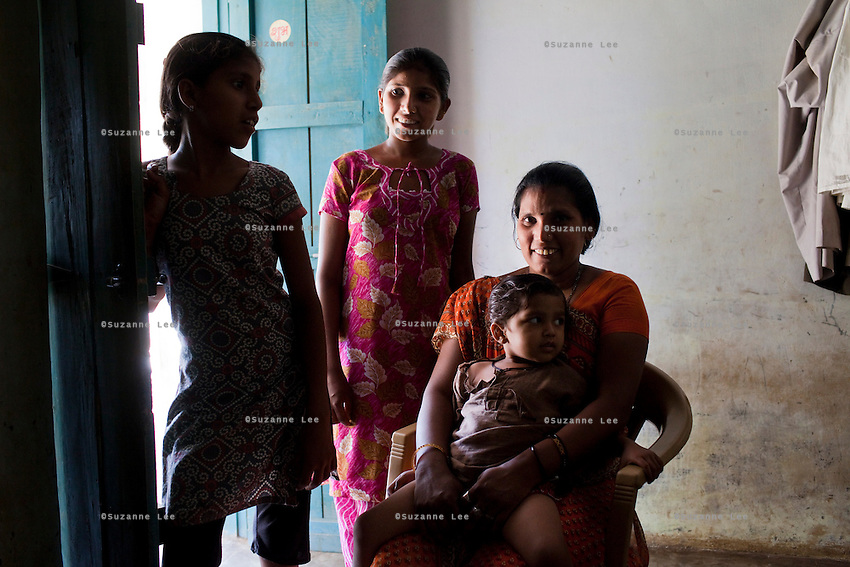 "Shardaben Kantiben, 31; Husband is Kantibhai Motibhai (37).3 children --- 2 girls -  Usha(15) and Lakshmi (18, in pink); 1 boy, Chintan (17).- Education costs for all three come to Rs. 15,000 per year.- Shardaben was a two-time surrogate. First time she gave birth to twin girls for a Taiwanese couple and the second time a boy for an Indian couple from America (photo on TV set because she's proud that it was a boy).- The second time she became emotional and they got a gold ring of Rs. 1,500 made for the boy, which they presented to the biological parents. They are not in touch with either couple..- From the two surrogacies, they earned a little over 700,000rupees..-200,000rupees will be given as dowry for Lakshmi's wedding..- They leased agricultural land (Rs. 2 lakhs for five years) which earns them Rs. 60,000-70,000 a year; they bought two buffaloes worth Rs. 60,000 and make almost 6000-7000 per month selling milk; they bought a motorbike for Rs. 25,000; they put some money into house repairs and the construction of toilets, and opened a fixed deposit in Shardaben's name for Rs. 1.5 lakh and one in the name of their son, Chintan, for Rs. 25,000..Quotes..""Everyone says they'll keep in touch and take down addresses and phone numbers but nobody looks back. And I guess it works well. Our main interest was in the money. Their main interest is in the baby."" - KantiBhai.""Their rules apply at the surrogate house. It does curtail the freedom. When I used to go, everybody would just be lying. They count the days when they can go back."" - Kantibhai.""Ours is natural birth but surrogacy is a man-made pregnancy. There's a lot of risk. She must have taken at least 300 injections."" - Kantibhai of his wife...The Akanksha Infertility Clinic is known internationally for its surrogacy program and currently has over a hundred surrogate mothers pregnant in their environmentally controlled surrogate houses. .Photo by Suzanne Lee"