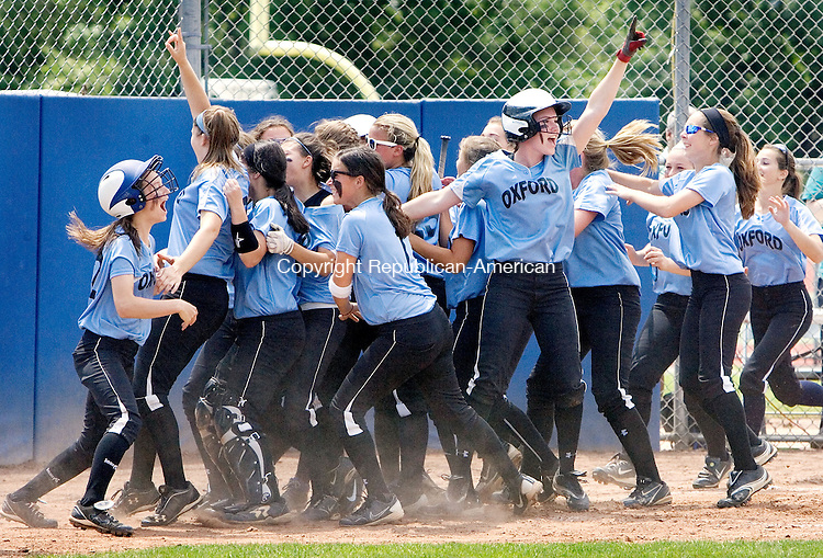 WEST HAVEN CT. 09 June 2013-060913SV02-Oxford High players celebrate at home plate after winning the CIAC Class S softball championship 1-0 against Terryville in West Haven on Sunday.<br /> Steven Valenti Republican-American