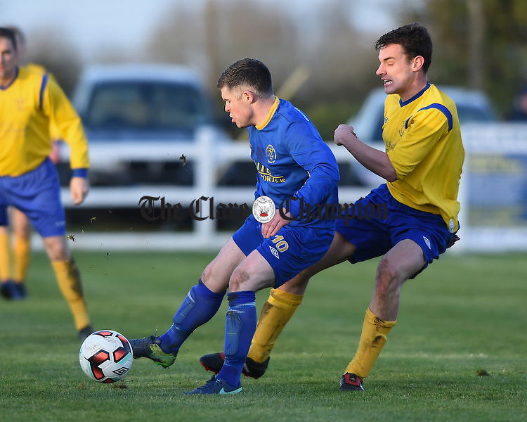 Darragh Concannon of  Roscommon  in action against Niall Whelan of Clare during their Oscar Traynor game in Frank Healy park, Doora. Photograph by John Kelly.