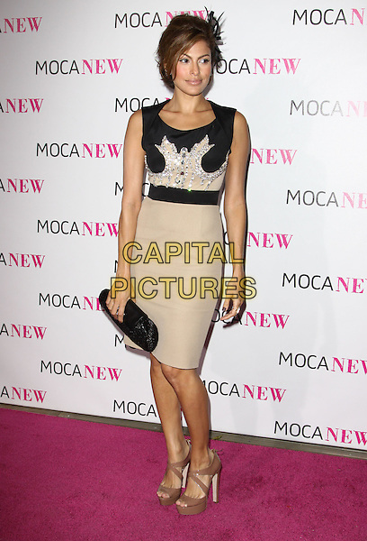 EVA MENDES .At MOCA's 30th Anniversary Gala held at MOCA, Los Angeles, California, USA, 14th November 2009. .full length mendez black sleeveless dress clutch bag beige jewel encrusted embellished brown patent platform shoes sandals .CAP/ADM/KB.©Kevan Brooks/AdMedia/Capital Pictures.