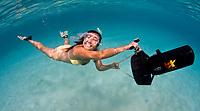 Snorkeler plays with underwater scooter, Bonaire, Netherland Antilles, Caribbean Sea, Atlantic Ocean, MR