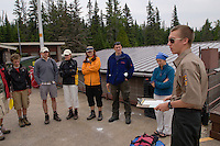 An Isle Royale National Park employee goes over rules and regulations with visitors to the park.