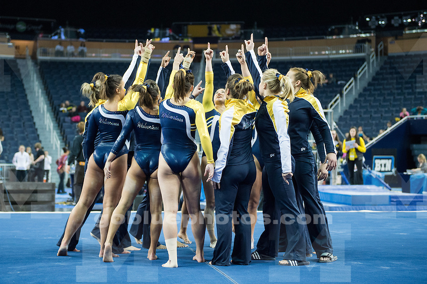 The University of Michigan women's gymnastics team falls to Oklahoma, 197.375-197.250, at Crisler Arena in Ann Arbor, Mich. on February 20, 2015.