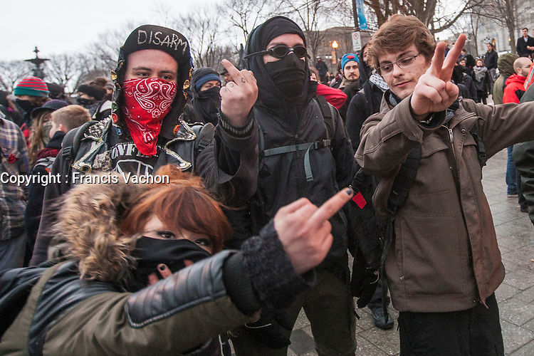 "A protester makes the ""peace sign"" as other masked protesters show the middle finger during a protest against austerity organized by the ASSE student group in Quebec city Thursday March 26, 2015.<br /> <br /> PHOTO :  Francis Vachon - Agence Quebec Presse"